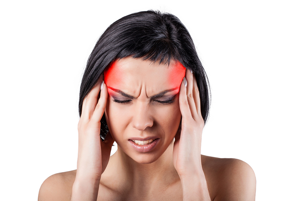 woman suffering from a terrible migraine